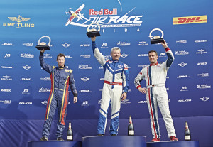 Matt Hall of Australia (L), Paul Bonhomme of Great Britain (C) and Matthias Dolderer of Germany (R) celebrate during the Award Ceremony of the second stage of the Red Bull Air Race World Championship in Chiba, Japan on May 17, 2015.